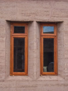 Wood Windows in rammed earth